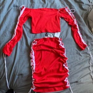 red skirt and off the shoulder cropped shirt set